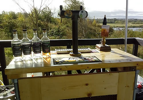 Mobile bar hire services by Yorkshire Craft Beers serving craft beer to customers