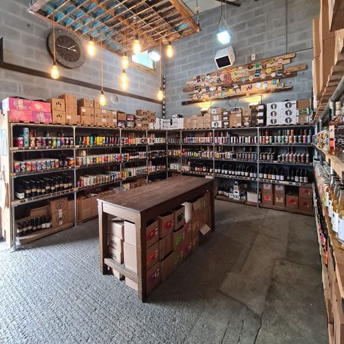 Shop interior showing craft beers on shelves